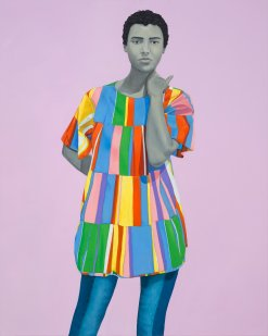 Portrait of a woman with a multicoloured dress over a lilac background.