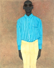 Portrait of a men with sunglasses and a striped light blue shirt.