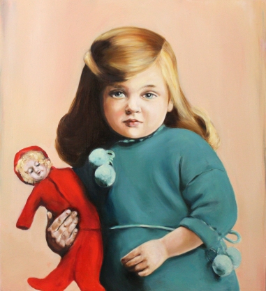 Portrait of a baby girl with a turquoise dress holding a red dressed doll.