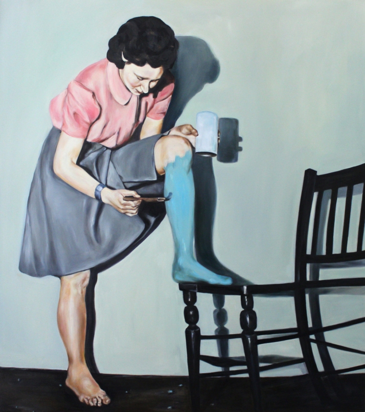 Full body portrait of a woman that is painting her leg with a blue colour.