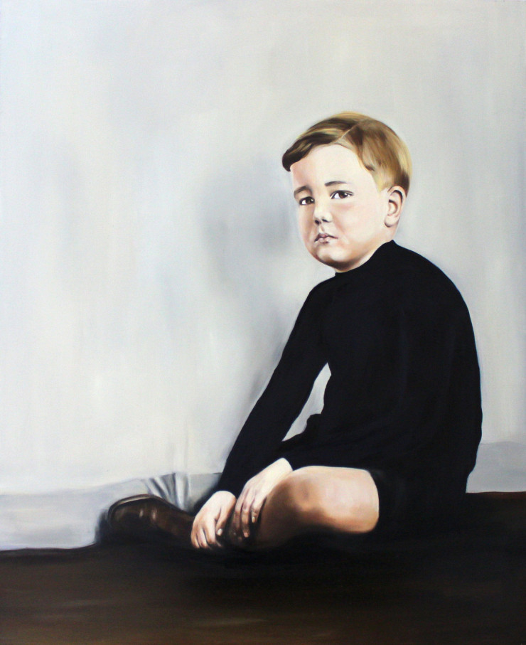 Full body portrait of a baby boy sit on the ground.