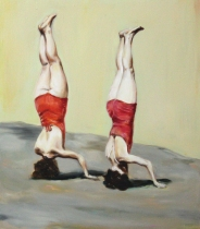 Full body portrait of two women in red bathing suit seen from their back and upside down.
