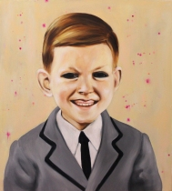 Portrait of a young smiling boy with black eyes.