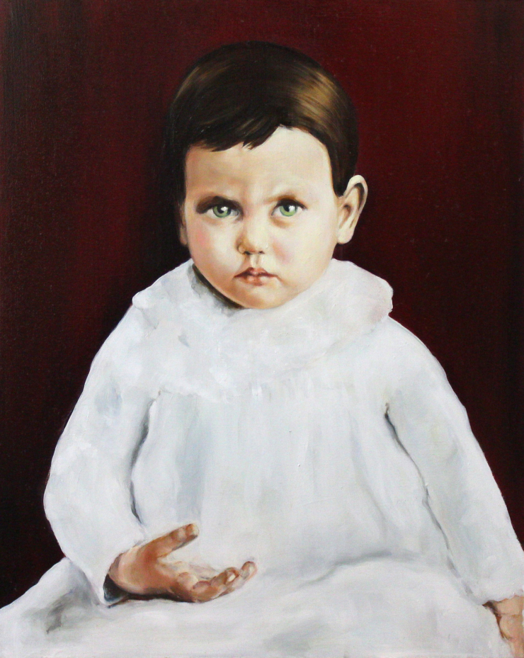 Portrait of a baby with a white dress.