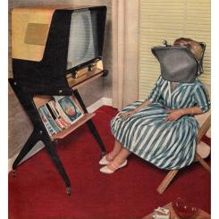 Portrait of a woman watching tv with the face covered by a giant coin purse.