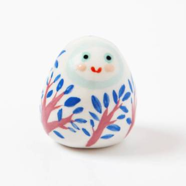 Sill life photo of a ceramic lucky charm.