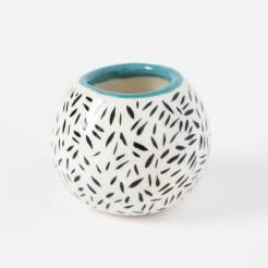 Still life photo of a ceramic vase.