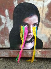 Embroidered street art portrait.