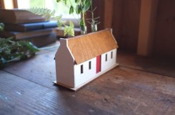 Still life photo of a miniature mill house.