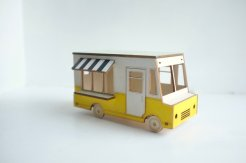 Still life of a miniature food truck.