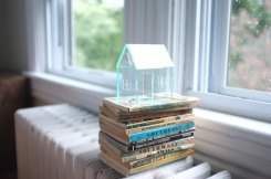 Still life photo of a miniature house.