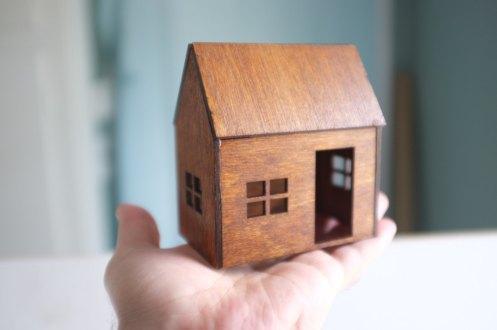 Still life of a miniature birch house.