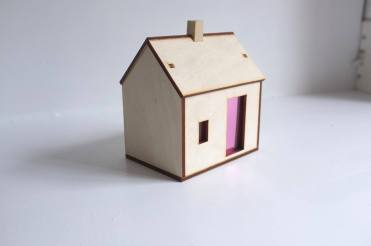Still life of a miniature wooden house.