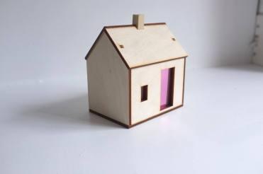 Still life of a miniature wooden house.