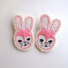 couple of embroidered bunny brooches.
