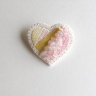 Heart shaped embroidered brooch.