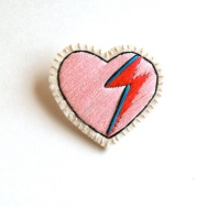 Pink heart shaped embroidered brooch.