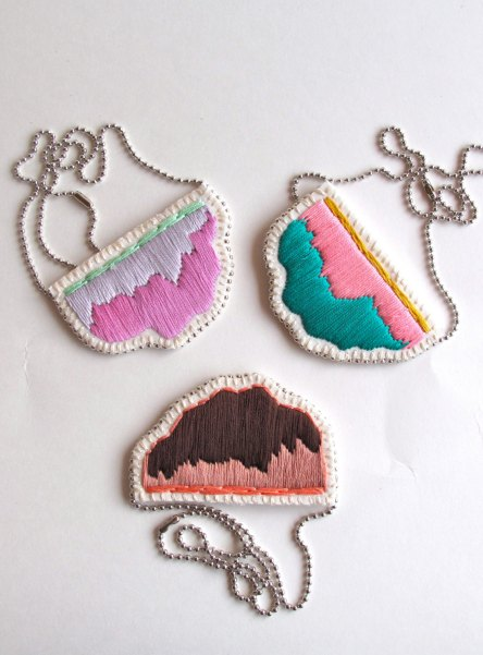Trio of multicolour pendant necklaces.
