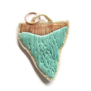 Mint green embroidered pendant necklace.