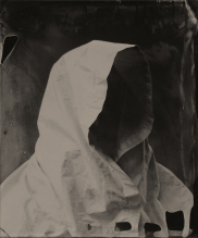 Portrait of a faceless person wearing a hood.