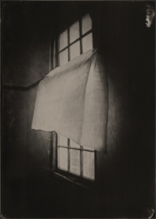 Still life of a cloth and a window.
