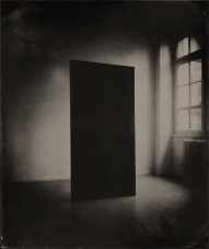 Still life of a black panel into a room.