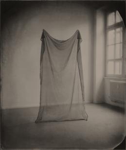 Still life of a cloth into a room.
