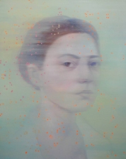 Woman portrait decorated with orange dots.