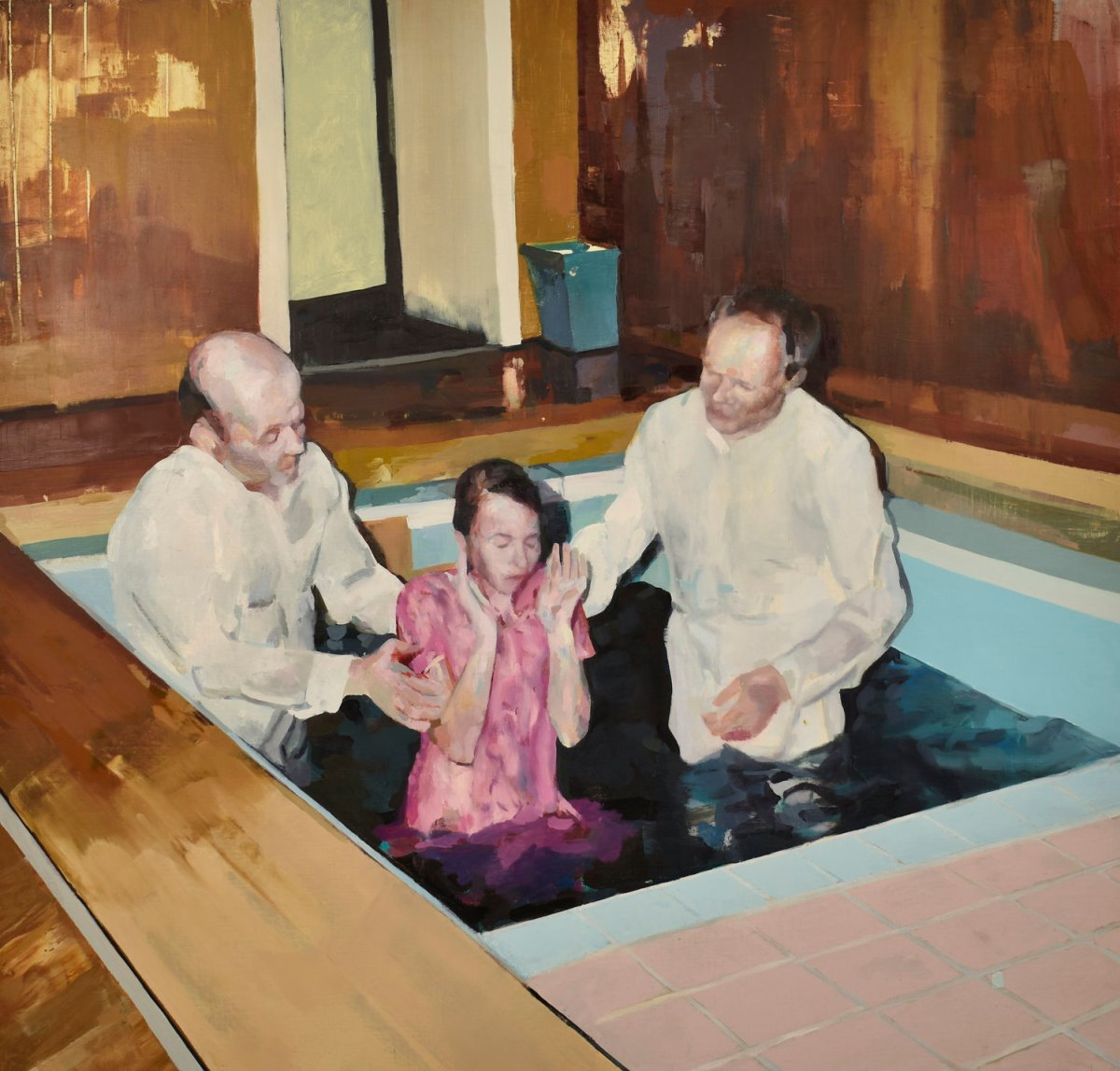 Portrait of a baptism into an indoor pool of a young woman.