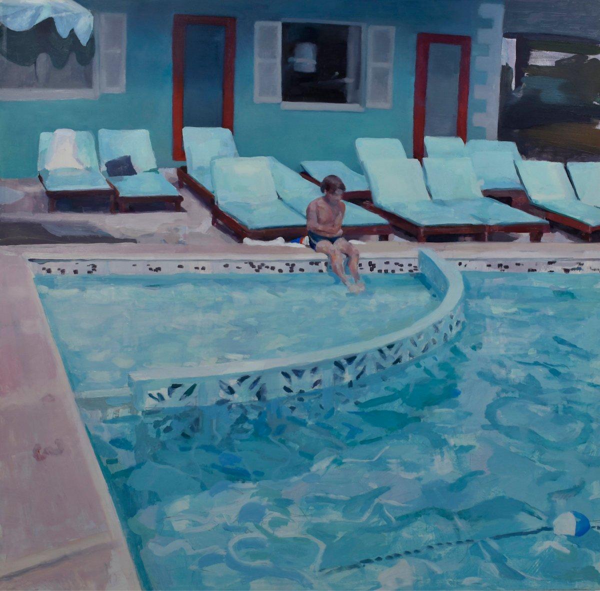 Kid sit on a poolside.