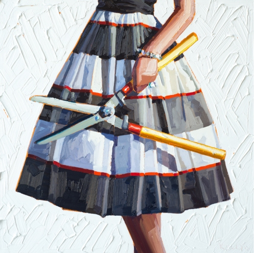 Woman torso with a black, white and red striped dress holding garden scissors.