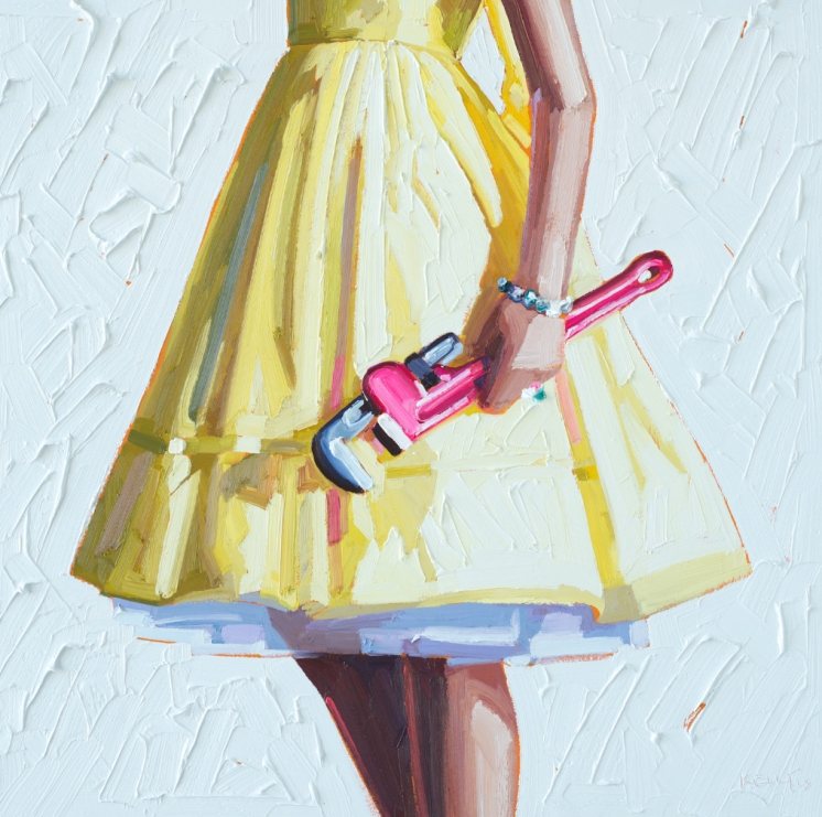 Woman torso wearing a yellow dress and holding a wrench
