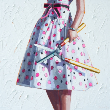 Woman torso with a pink and white dotty dress holding garden scissors.