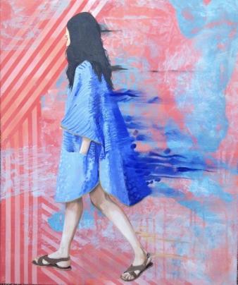 Full body profile portrait of a woman walking dressed in blue.