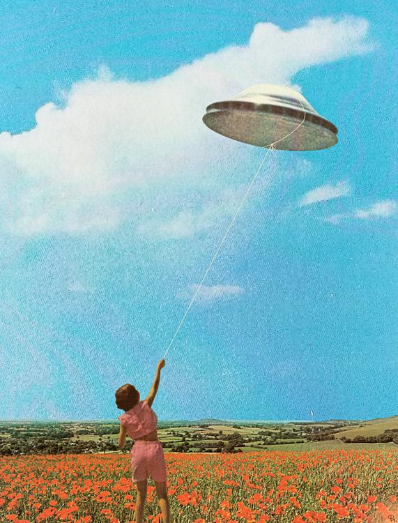 Woman holding an ufo kite.