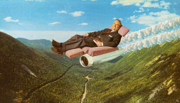 Man sit on a sofa floating into a mountain landscape.