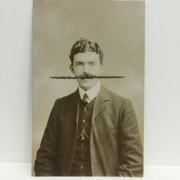 Still life photo of a vintage male portrait.
