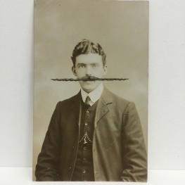 Still life photo of a vintage male portrait.