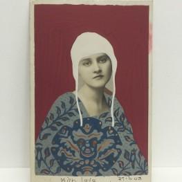 Still life photo of a vintage female portrait.