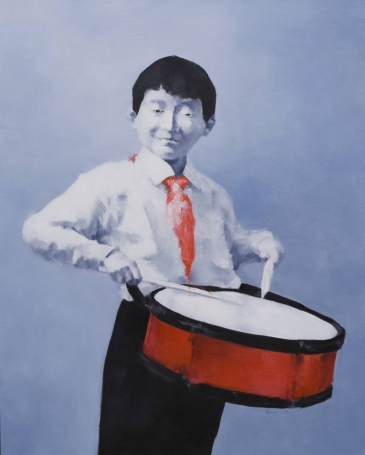 Portrait of a young boy playing the drums.