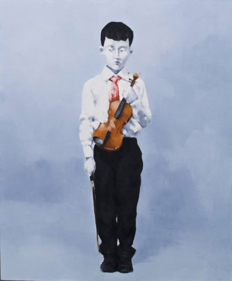 Portrait of a young boy holding a violin.