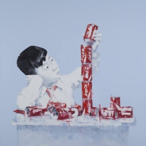 Portrait of a young boy playing with cans.