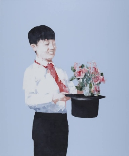 Portrait of a young boy holding a hat and a flower bouquet.
