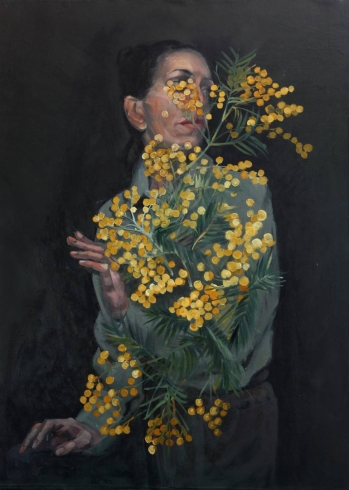Woman portait with yellow flowers.