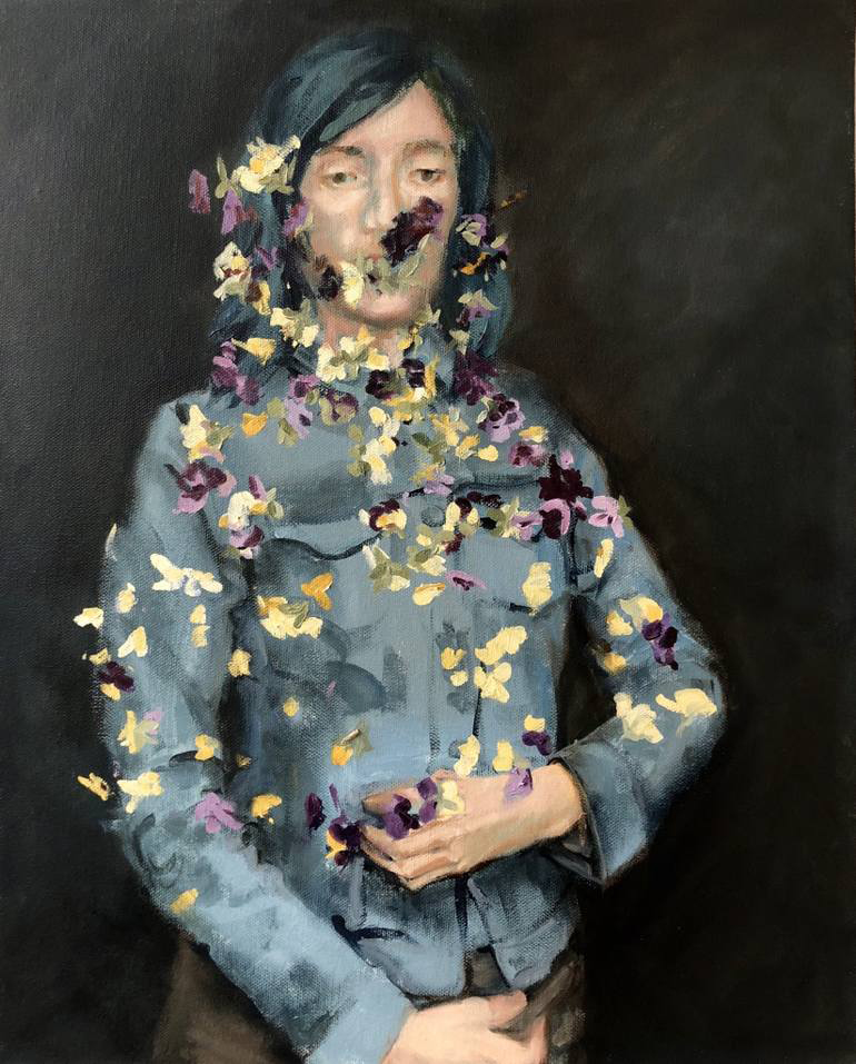 Woman portait with viola flowers.