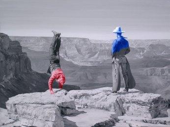 Two cowboys on a desert landscape.