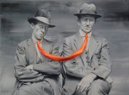 Couple of men portrait with a linked tie.