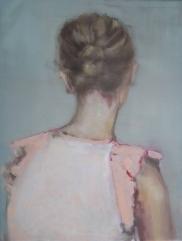Female portrait seen from her back wearing a beige blouse.