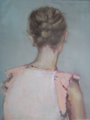 Female portrait seen from her back wearing a beige blouse.