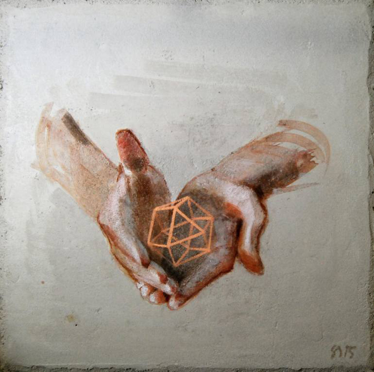 Hands holding a geometric element.